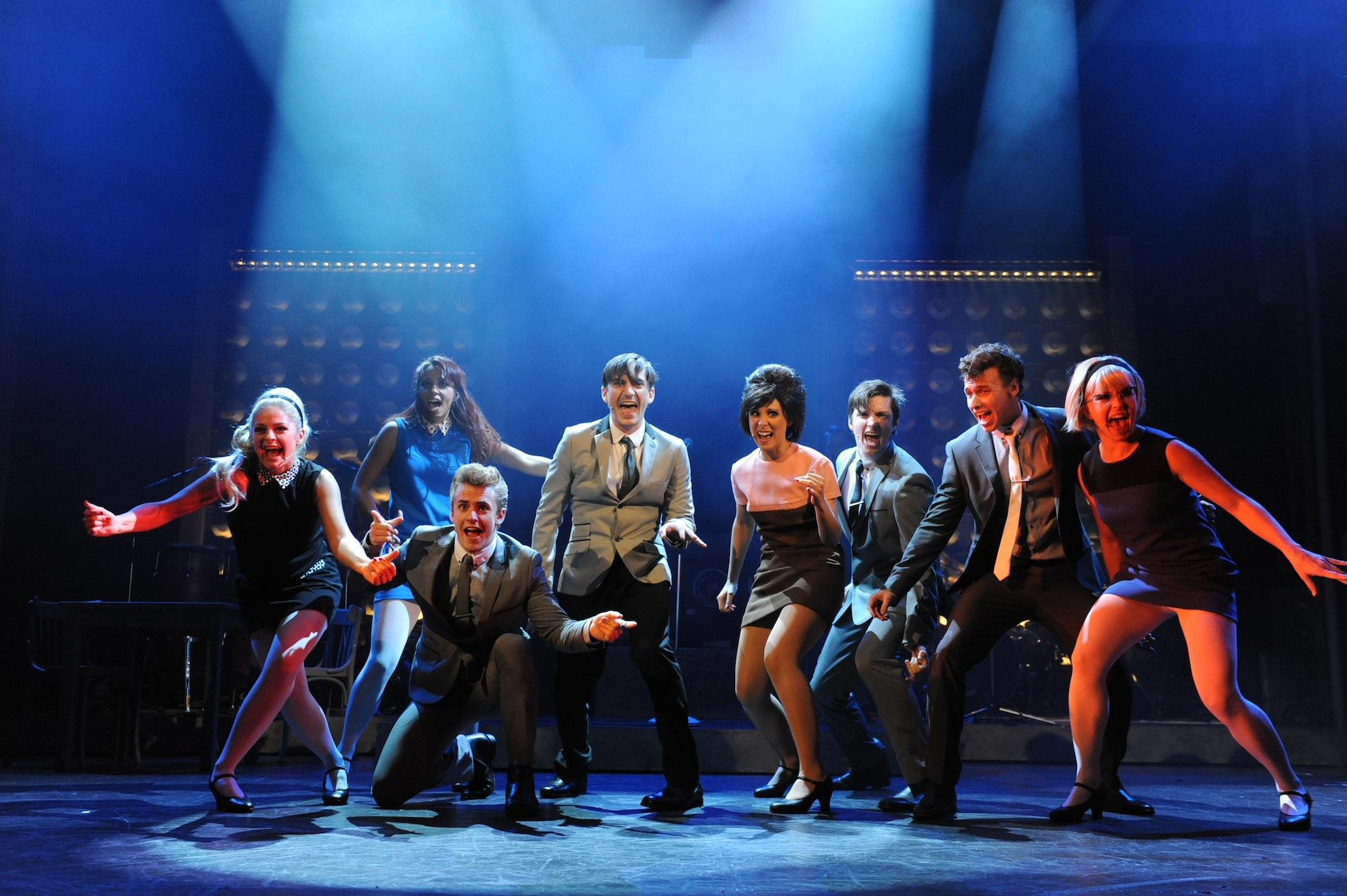 Image of full cast dancing