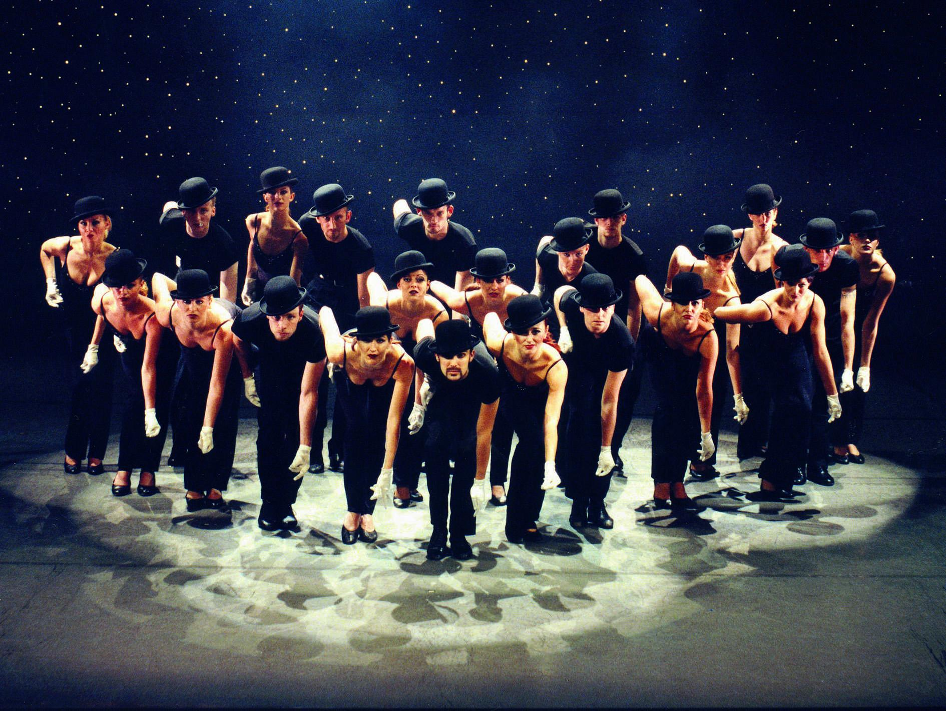 image of dancers performing a fosse-esque rountine