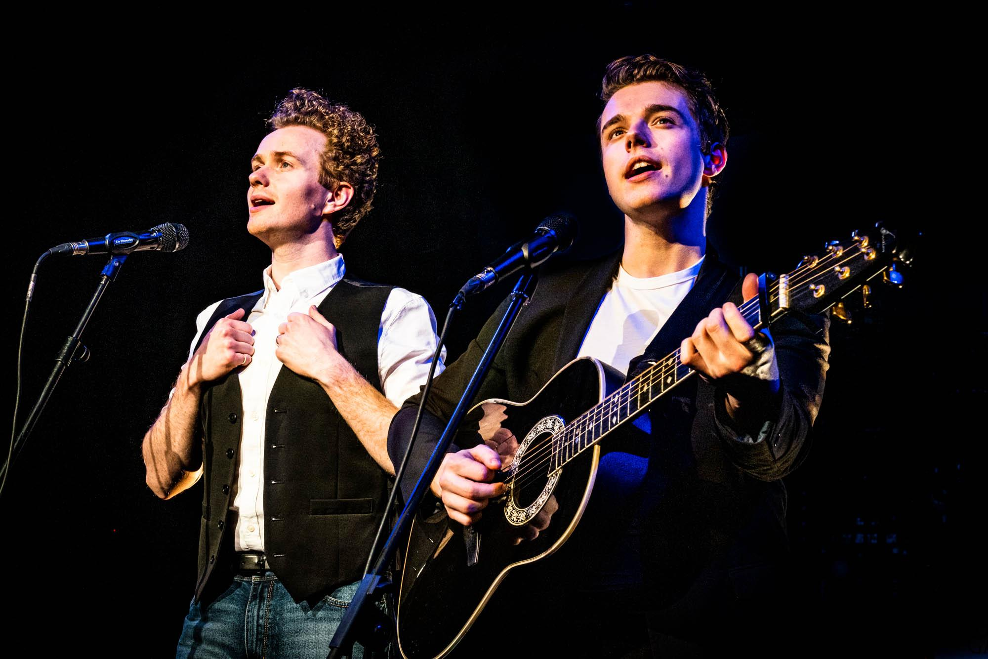image of two singers playing guitars