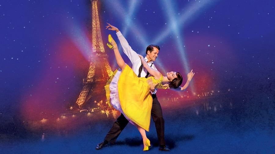 Image of two dancers in front of the Eiffel Tower
