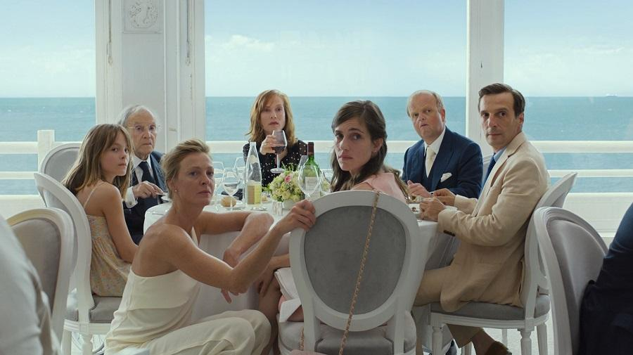 image of the cast sat at a dining table