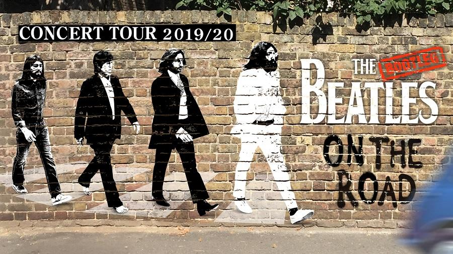 image of the Beatles painted on a brick wall