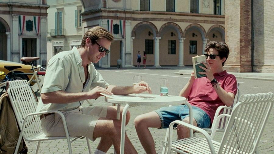 Image of Elio and Oliver sat in a square reading