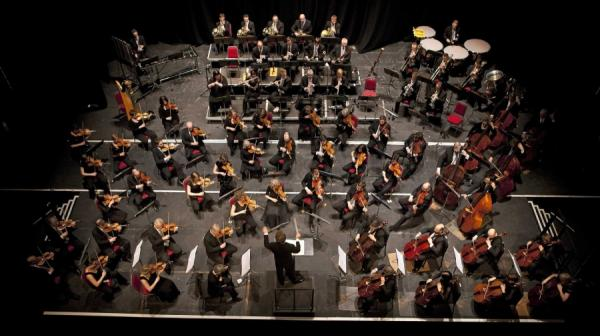 image of an orchestra playing from above the stage