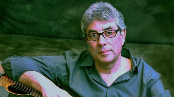 Graham Gouldman with a guitar