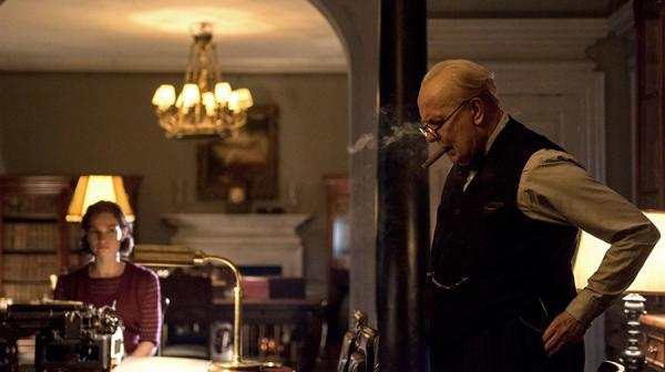 Image of Gary Oldman as Winston Churchill with his secretary