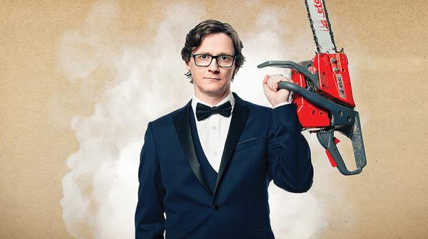 Image of Ed Byrne with a chainsaw
