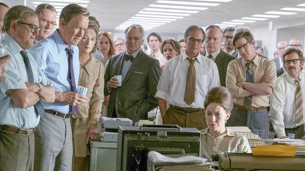 Image of the Washington Post staff watching the TV in the newsroom