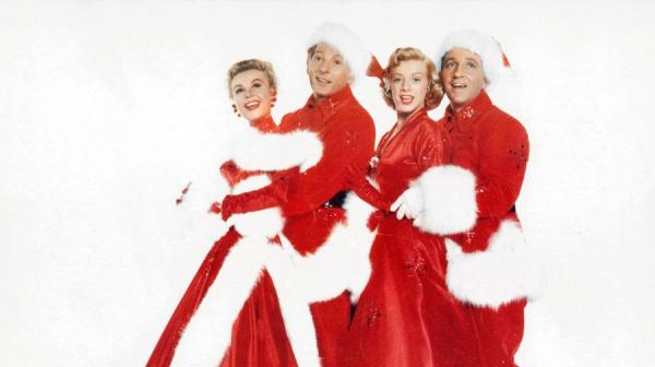 a photo of the cast of White Christmas wearing festive outfits